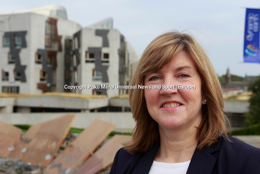 A portrait of  Alison Johnstone in the Dynamic Earth with Scottish Parliament in the background.<br /> Green MSP to hit independence referendum trail. Alison Johnstone to highlight how voting Yes on September 18 could help set up a small business revolution in the Dynamic Earth, Edinburgh.<br /> Pako Mera/Universal News And Sport (Europe) 09/09/2014