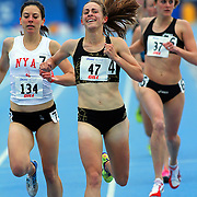 SIMPSON, Jennifer - USA, wins the women's special 1500 in 4:12.95, at the 2012 Drake Relays. Simpson held off Maggie Infield, left.   photo by david peterson