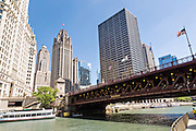 Tribune Tower and the DuSable Bridge viewed from Riverwalk on a summers day in Chicago, Illinois, USA