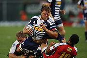 Duane Vermeulen is tackled during the Super Rugby (Super 15) fixture between the DHL Stormers and the Lions held at DHL Newlands Stadium in Cape Town, South Africa on 26 February 2011. Photo by Jacques Rossouw/SPORTZPICS