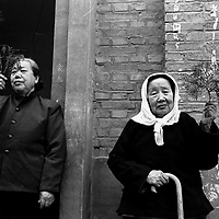 LIUJIAZHUANG VILLAGE, 8 APRIL 2001: elderly women women pray on Palm Sunday in an official church. China cut relations with the Vatican in the early fifites and since then, established a Patriotic catholic Church that's controlled by Chinese authorities.<br />Catholics who refused to give up their ties with the Vatican, started worshipping in underground churches and consequently were persecuted for a long time. Since the late nineties though, relations with the Vatican informally started to improve. Although China still has no diplomatic relations, many representatives from official churches met the pope John Paull II secretely . The Vatican, under the pope's leadership, has made several efforts to recover the tie with China. In February 2006 , Hong Kong Bishop Joseph Zen was named one of the first 15 new cardinals, which is seen by many as a gesture of goodwill and a significant step towards recovering the Vatican-China relationship.