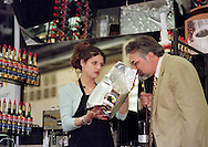 Christina Gibbs, left, of Saginaw, Michigan, holds up the brand of coffee she was using to make espresso, as Paul Songer, one of the judges, sniffs the beans, during the Torani 5th Annual Barista Cup, Saturday, May 1, 1999, in Philadelphia. Gibbs was named second runner up in the competition, Monday, May 3, 1999. (Photo by William Thomas Cain)