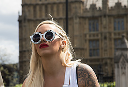 "Westminster, London, May 24th 2016. Animal rights protesters from ""Boycott Dogs4Us"" protest outside Parliament against puppy farming and third party puppy selling as the Environment, Food and Rural Affairs Sub-Committee are investigating the sale of dogs as part of their animal welfare inquiry. PICTURED: Celebrity guest speaker and dog lover Jodie Marsh"