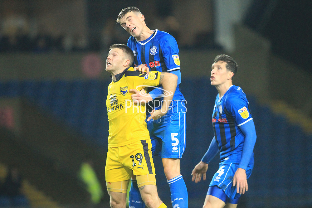 Ryan Delaney beats Jamie Mackie to a header during the EFL Sky Bet League 1 match between Oxford United and Rochdale at the Kassam Stadium, Oxford, England on 27 November 2018.