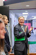 (Left to right) Drew Stroud, a senior in mechanical engineering, and Duane Nellis, Ohio University president, listen to David Pidwell, national trustee, speak at the grand opening and ribbon cutting for the new CoLab, October 18, 2018. (Photo by Stephen Zenner/Ohio University Libraries)