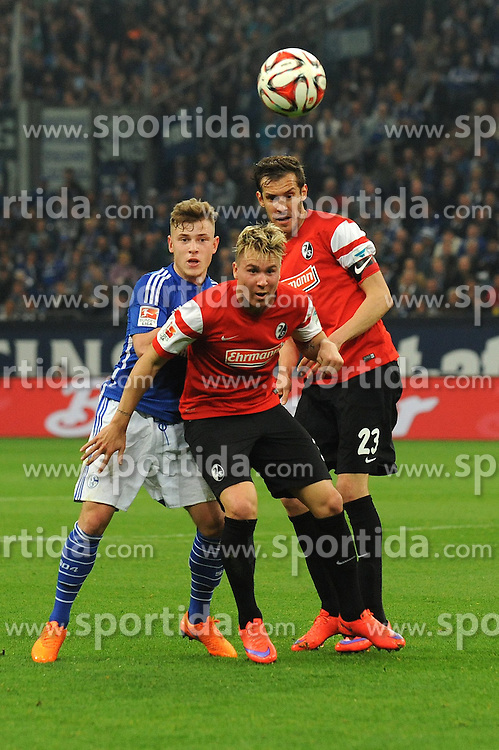 11.04.2015, Veltins Arena, Gelsenkirchen, GER, 1. FBL, Schalke 04 vs SC Freiburg, 28. Runde, im Bild Felix Klaus ( mitte ) und Julian Schuster ( rechts beide SC Freiburg ) im Zweikampf mit Max Meyer ( links Schalke 04 ) // during the German Bundesliga 28th round match between Schalke 04 and SC Freiburg at the Veltins Arena in Gelsenkirchen, Germany on 2015/04/11. EXPA Pictures &copy; 2015, PhotoCredit: EXPA/ Eibner-Pressefoto/ Thienel<br /> <br /> *****ATTENTION - OUT of GER*****