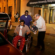 At 9:30 p.m., eight days after surgery, Steve is wheeled out of the hospital by Silbert Richards. His stepfather, Paul Scalia, is ready to drive him home.