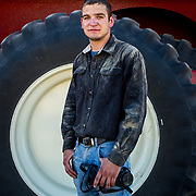 Alan Stoner, 21, and his harvesting crew mates have travelled through Texas, Oklahoma, Kansas, Colorado, Nebraska, and Idaho, cutting wheat crops as they ripen. Alan is a full time harvester and an aspiring farm owner with dreams of becoming a helicopter pilot. Near Hamer, Idaho, August 18, 2017.