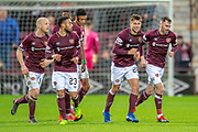 Marcus Godinho (#26) of Heart of Midlothian is all smiles as he celebrates with team mates after scoring the opening goal for Hearts during the Ladbrokes Scottish Premiership match between Heart of Midlothian FC and St Johnstone FC at Tynecastle Stadium, Edinburgh, Scotland on 26 January 2019.