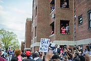 Baltimore, Maryland - April 21, 2015: Protestors and media gather at the site in West Baltimore where Freddie Gray was detained by the police during a vigil-turned-protest march Tuesday April 21, 2015. Gray was injured during police detainment and died from his injuries a week later last Sunday. His spinal cord was 80% severed.<br /> <br /> CREDIT: Matt Roth for The New York Times<br /> Assignment ID: 30173645A