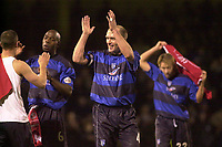 Photo. Glyn Thomas.<br /> Gillingham v Charlton. FA Cup Third Round.<br /> Priestfield Stadium. 03/01/2004.<br /> Gillingham's Paul Smith, scorer of his side's third and winning goal, applauds the crowd along with Danny Spiller (R) and Ian Cox.