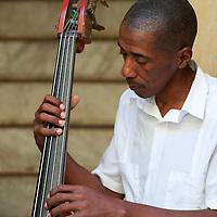 Portrait of a bass player in Havana, Cuba