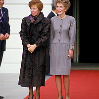 Raisa Gorbachev and Nancy Reagan stop for photographers at the south entrance to the White House. Wrinkled stockings worn by Mrs. Gorbachev highlighted in Bunte magazine.