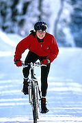 Female cyclist with helmet on a Mountain Bike in snow;<br /> Leisure Sports - Cycling,<br /> Model Released,<br /> Brandon, Vermont, USA, 1999,<br /> &copy; Sport the library / Dennis Welsh