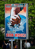 An anti US propaganda poster in North Korea.<br /> -You don&rsquo;t seem to like the Americans.<br /> -They meddle in everything Mr. Eric! Nobody likes them! The whole world is against them: Chavez, Castro, Ghaddafi, El Assad, Than Shwe, Ahmadineja, everyone! And Guantanamo!