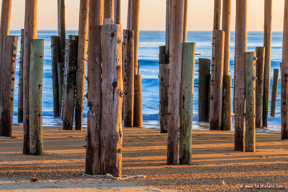 Pilings in the morning light at Kitty Hawk Fishing Pier North Carolina.