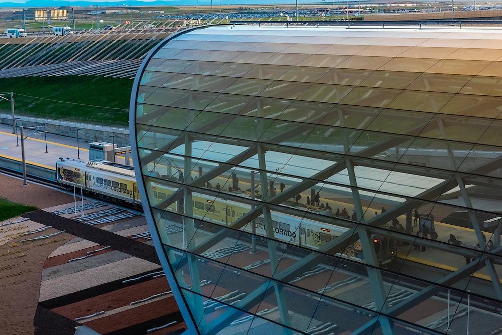 A glass canopy covers the train station at Denver International Airport, Denver, Colorado USA.