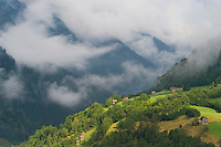 IFTE-NB-007926; Niall Benvie; Cut hay meadows near Fliess; Austria; Europe; Austria; Tirol; clouds mist hut building hay barn fields; horizontal; high above steep; green; farmland grassland meadow; 2008; July; summer; mist; agriculture; Wild Wonders of Europe Naturpark Kaunergrat