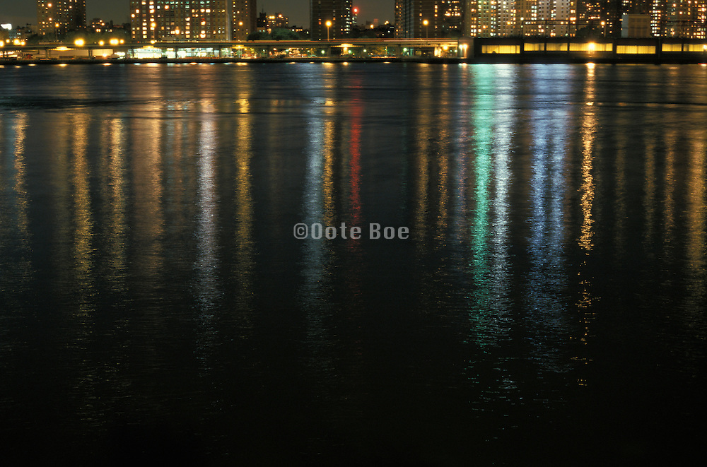 Reflection of city lights on water