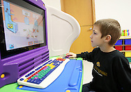 Noah Hines, 7, of Cedar Rapids plays a game on the computer at Building Blocks Child Care in Cedar Rapids on Wednesday February 25, 2009.  (Stephen Mally/Freelance)