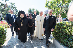 """21 June 2018, Geneva, Switzerland: On 21 June 2018, the World Council of Churches receives a visit from Pope Francis of the Roman Catholic Church. Held under the theme of """"Ecumenical Pilgrimage - Walking, Praying and Working Together"""", the landmark visit is a centrepiece of the ecumenical commemoration of the WCC's 70th anniversary. The visit is only the third by a pope, and the first time that such an occasion was dedicated to visiting the WCC. Here, an ecumenical prayer service with religious leaders from all over the world. Here, Pope Francis enters the Ecumenical Centre with Metropolitan Gennadios of Sassima, Cardinal Koch, Dr Agnes Abuom, Rev. Dr Olav Fykse Tveit."""