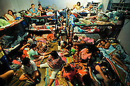 Women sleep on the floor, under the beds and four to each bunk bed at Ilopango Women's prison in San Salvador, El Salvador.