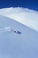 Snowboarder on slope elegated view