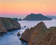 0603-2033 ~ Copyright: George H.H. Huey ~ Full moon at dawn from East Anacapa Island.  Channel Islands National Park, California.