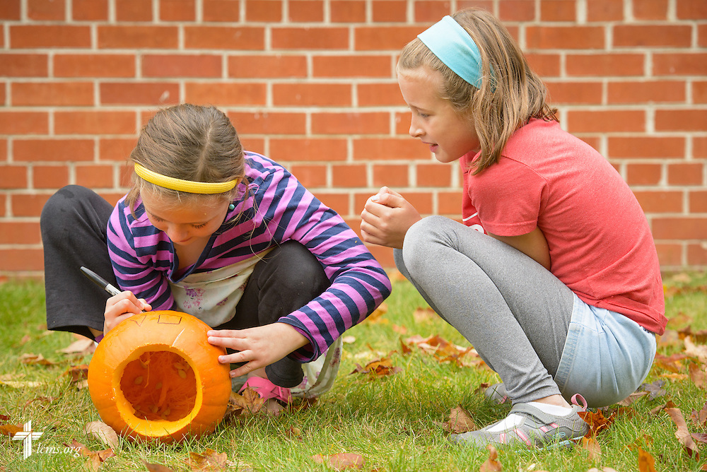 4th grade students mark pumpkins for carving during an outside classroom activity on Thursday, Oct. 27, 2016, at First Immanuel Lutheran School in Cedarburg, Wis. LCMS Communications/Erik M. Lunsford
