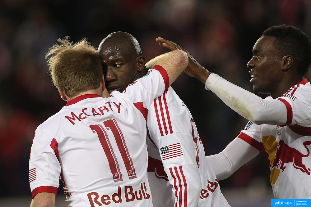 Bradley Wright-Phillips, New York Red Bulls, is congratulated by Dax McCarty and Lloyd Sam, (right),  after scoring the winning goal in the 90th minute to lead his side to a 2-1 victory during the New York Red Bulls V Sporting Kansas City, Major League Soccer Play Off Match at Red Bull Arena, Harrison, New Jersey. USA. 30th October 2014. Photo Tim Clayton