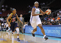 June 3, 2012; Newark, NJ, USA; New York Liberty forward Kara Braxton (45) dribbles the ball while being defended by Indiana Fever guard Briann January (20) during the first half at the Prudential Center.