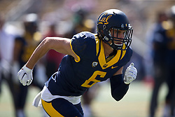 BERKELEY, CA - OCTOBER 03:  Wide receiver Carlos Strickland #6 of the California Golden Bears warms up before the game against the Washington State Cougars at California Memorial Stadium on October 3, 2015 in Berkeley, California. The California Golden Bears defeated the Washington State Cougars 34-28. (Photo by Jason O. Watson/Getty Images) *** Local Caption *** Carlos Strickland