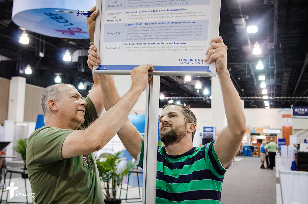 Workers prepare an exhibit for Concordia Plan Services  on Friday, July 8, 2016, before the start of the 66th Regular Convention of The Lutheran Church–Missouri Synod at the Wisconsin Center in Milwaukee. LCMS Communications/Frank Kohn