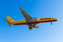 A DHL Boeing 757 lands at London's Heathrow Airport (LHR / EGLL).