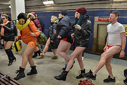 "© Licensed to London News Pictures. 07/01/2018. CHICAGO, USA.  Participants take part in song and dance during the annual ""No Pants Subway Ride"", a fun event taking place both in Chicago and worldwide, where people ride the subway wearing no trousers.  With Chicago experiencing an extreme cold snap currently, temperatures made taking part more challenging.  Photo credit: Stephen Chung/LNP"