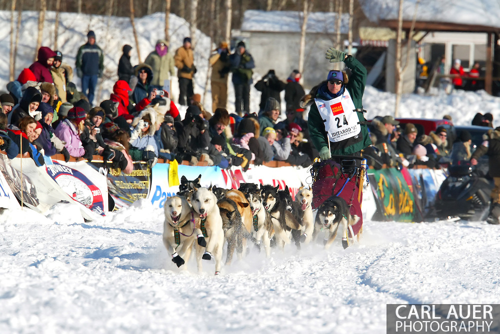 3/4/2007:  Willow, Alaska -  Waving to the crowd, Rookie Jon Korta of Galena, AK heads across Willow Lake during the start of the 35th Iditarod Sled Dog Race