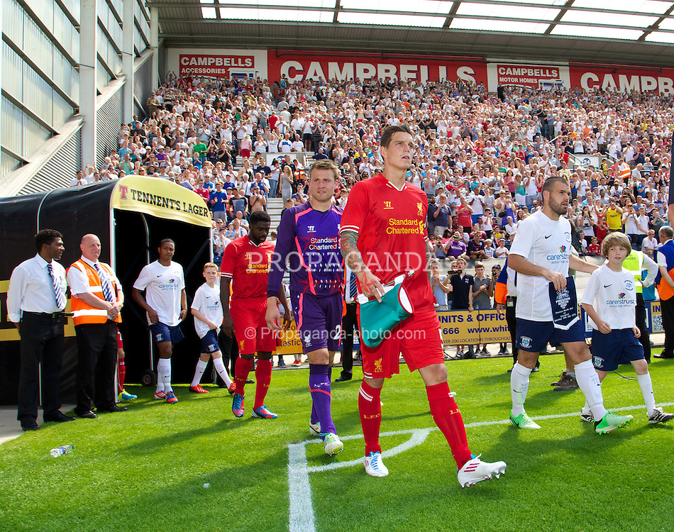 PRESTON, ENGLAND - Saturday, July 13, 2013: Liverpool's captain Daniel Agger leads his side out to face Preston North End during a preseason friendly match at Deepdale. (Pic by David Rawcliffe/Propaganda)