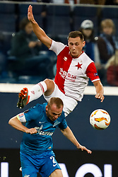 October 4, 2018 - Saint Petersburg, Russia - Aleksandr Anyukov of FC Zenit Saint Petersburg and Jan Boril (top) of SK Slavia Prague vie for the ball during the Group C match of the UEFA Europa League between FC Zenit Saint Petersburg and SK Sparta Prague at Saint Petersburg Stadium on October 4, 2018 in Saint Petersburg, Russia. (Credit Image: © Mike Kireev/NurPhoto/ZUMA Press)