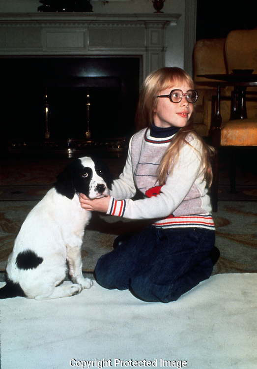 A 29.5 MG IMAGE OF:.Amy Carter with her new Puppy in the Dioplomatic reception room of the White House on January 2, 1977--Jimmy Carter's first full as President.  .This image was the cover of TIME for that week. Photo by Dennis Brack B 1