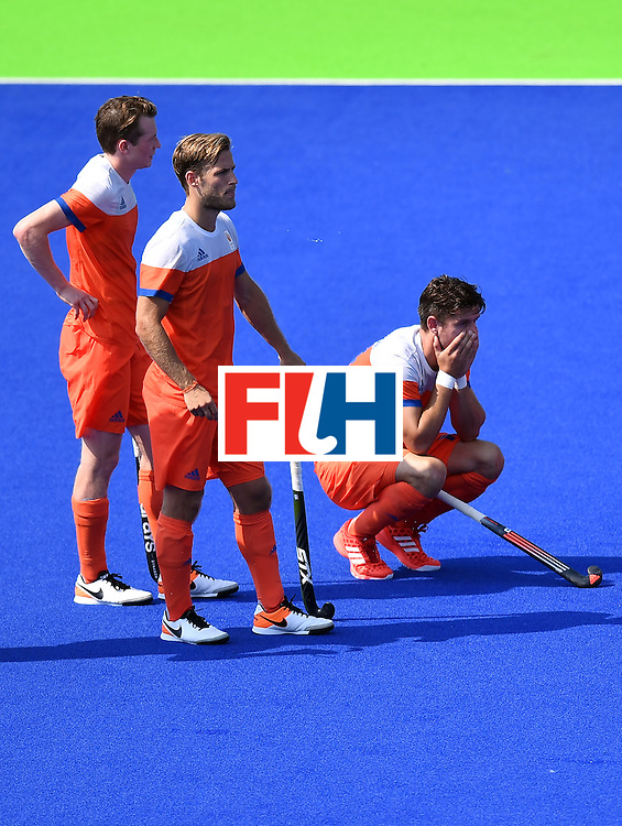 Netherlands' players react after missing the men's Bronze medal field hockey Netherlands vs Germany match of the Rio 2016 Olympics Games at the Olympic Hockey Centre in Rio de Janeiro on August 18, 2016. / AFP / MANAN VATSYAYANA        (Photo credit should read MANAN VATSYAYANA/AFP/Getty Images)