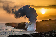 Under a golden sunset, glowing lava exits a lava tube, jets into the ocean and explodes at Kamokuna, enlarging the Big Island, in Hawaii Volcanoes National Park, just west of Kalapana, Hawaii, USA, on February 1, 2017. On Kilauea volcano's south flank, Pu'u O'o crater has been erupting continuously since 1983, making it the world's longest-lived rift-zone (flank) eruption of the last 200 years. The eruption has consumed 189 buildings and 8.7 miles of highway. Since 1987, the coastal highway has been closed, buried under lava up to 115 feet thick. After June 30, 2016, the County of Hawaii opened a section of the emergency road/Highway 130 to lava viewing (8 miles round trip, open 3pm-9pm), limiting vehicles to bicycles (rented at the roadblock in Kalapana for $15+ for 3 hours), local residents' cars, and emergency vehicles. See updates at: USGS Hawaiian Volcano Observatory (HVO) http://hvo.wr.usgs.gov and www.hawaiicounty.gov/lava-viewing/. Kilauea is between 300,000 and 600,000 years old and emerged above sea level about 100,000 years ago.