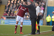 Northampton Town Manager Chris Wilder gives instructions to Northampton Town Midfielder Lawson D'ath during the Sky Bet League 2 match between Northampton Town and Newport County at Sixfields Stadium, Northampton, England on 25 March 2016. Photo by Dennis Goodwin.