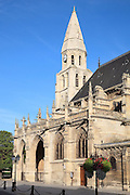 Western portico and bell tower, Collegiale Notre-Dame de Poissy, showing the Western bell tower and chapels of the North aisle, a catholic parish church founded c. 1016 by Robert the Pious and rebuilt 1130-60 in late Romanesque and early Gothic styles, in Poissy, Yvelines, France. Saint Louis was baptised here in 1214. The Collegiate Church of Our Lady of Poissy was listed as a Historic Monument in 1840 and has been restored by Eugene Viollet-le-Duc. Picture by Manuel Cohen