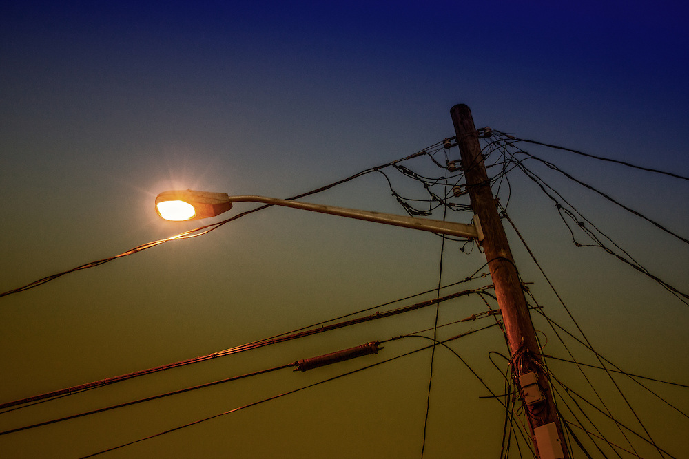A street light comes on at dusk in Cape May, New Jersey.