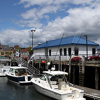 View of Long Wharf pier at the waterfront of Portland, Maine, USA. Long Wharf pier is a departure point for several scenic cruises of Casco Bay.