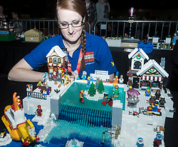 The SEC in Glasgow hosts Brick Live, the largest LEGO exhibition in the UK. Featuring models made up of over 6 million bricks, LEGO enthusiasts can build their own creations as well as admiring the models created by some of the leading designers including Scotland's Nick Clayton and Rocco Buttliere from Chicago.<br /> <br /> Pictured: Model builder Alison Clayton looking onto an Ice Skating scene made from LEGO