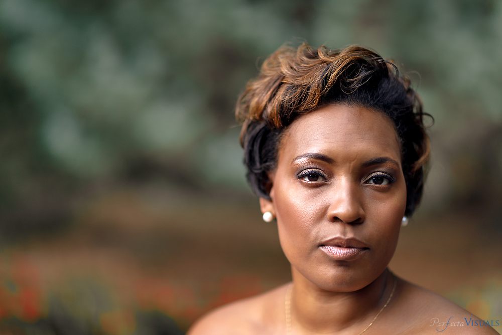 Jada Monica Drew is the CEO of Social Designs; a social justice consulting firm. Social Designs provides social justice solutions for organizations and people across the globe.  Jada&rsquo;s first book Revolutionize Now: Creative Leadership &amp; Action for Social Change is a movement equipping educators, social justice activists, and business leaders with tangible tools for radicalizing systems &amp; evolving self. Jada studied African American studies at Guilford College, where she was a Bonner Scholar. &ldquo;I love studying people. I love the cycle of systems and the way people interact,&rdquo; she says.<br /> <br /> Photographed, Thursday, August 24, 2017, in Greensboro, N.C. JERRY WOLFORD and SCOTT MUTHERSBAUGH / Perfecta Visuals