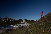 SAN FRANCISCO, CA - OCT 26:  Alan Good, Landscape Exhibits Supervisor on the living roof on top of the California Academy of Sciences building in Golden Gate Park on October 26, 2010 in San Francisco, California. San Francisco was recently rated the second greenest US city overall, narrowly beaten by Portland Oregon. The Living Roof´s 1.7 million native plants were specially chosen to flourish in Golden Gate Park´s climate.  After experimenting with thirty native species, the finalists were all able to self-propagate. They will thrive with little water, resist the salt spray from ocean air, and tolerate wind.  The roof will provide habitat for a wide variety of wildlife. A future project will seek to introduce the endangered San Bruno elfin butterfly and the Bay checkerspot butterfly to this new habitat.  Photography by David Paul Morris