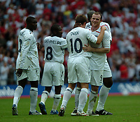 Photo: Tony Oudot.<br /> England v Estonia. UEFA European Championships Qualifying. 13/10/2007.<br /> Wayne Rooney of England is congratulated on his goal by Michael Owen