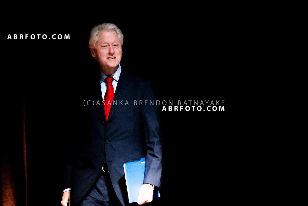 Former US President Bill Clinton enters teh stage before his speech which was disrupted by about 20 protestors belonging to the Robin Hood Tax coalition during a session of the 20th International AIDS conference held in Melbourne Australia. The former American President also paid tribute to the victims of Malaysian Airlines MH17 - Asanka Brendon Ratnayake